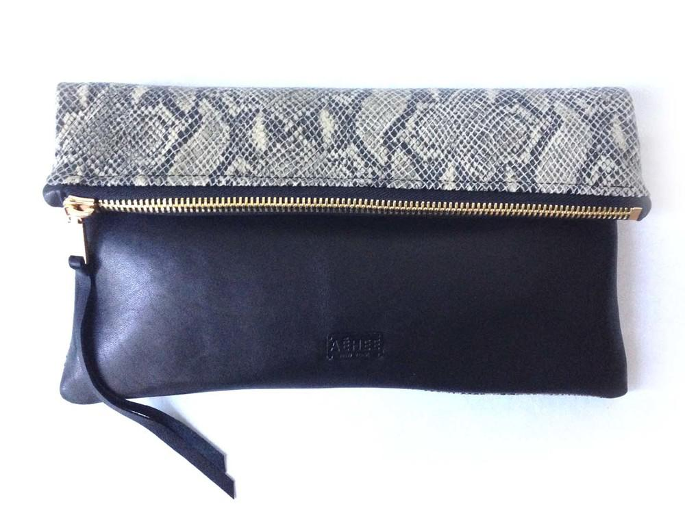 Oversized foldover leather clutch in python and black