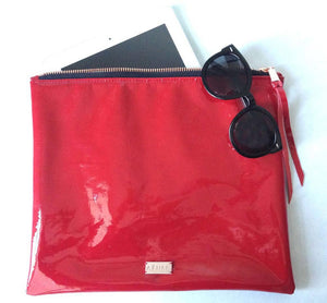 Oversized foldover leather clutch in crimson red patent