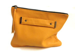 Oversized foldover clutch with strap metal end in mustard yellow