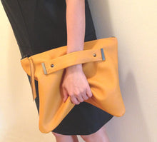 Load image into Gallery viewer, Oversized foldover clutch with strap metal end in mustard yellow
