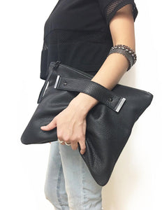 Oversized foldover clutch with strap metal end in pebble black