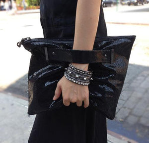 Oversized foldover clutch with strap metal end in crackle shiny black