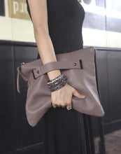 Load image into Gallery viewer, Oversized foldover clutch with strap metal end in taupe grey