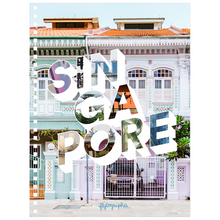 Load image into Gallery viewer, A medium-sized, 6.50x8.75 inch, spiral bound notebook with a picture of a place in Singapore on the cover