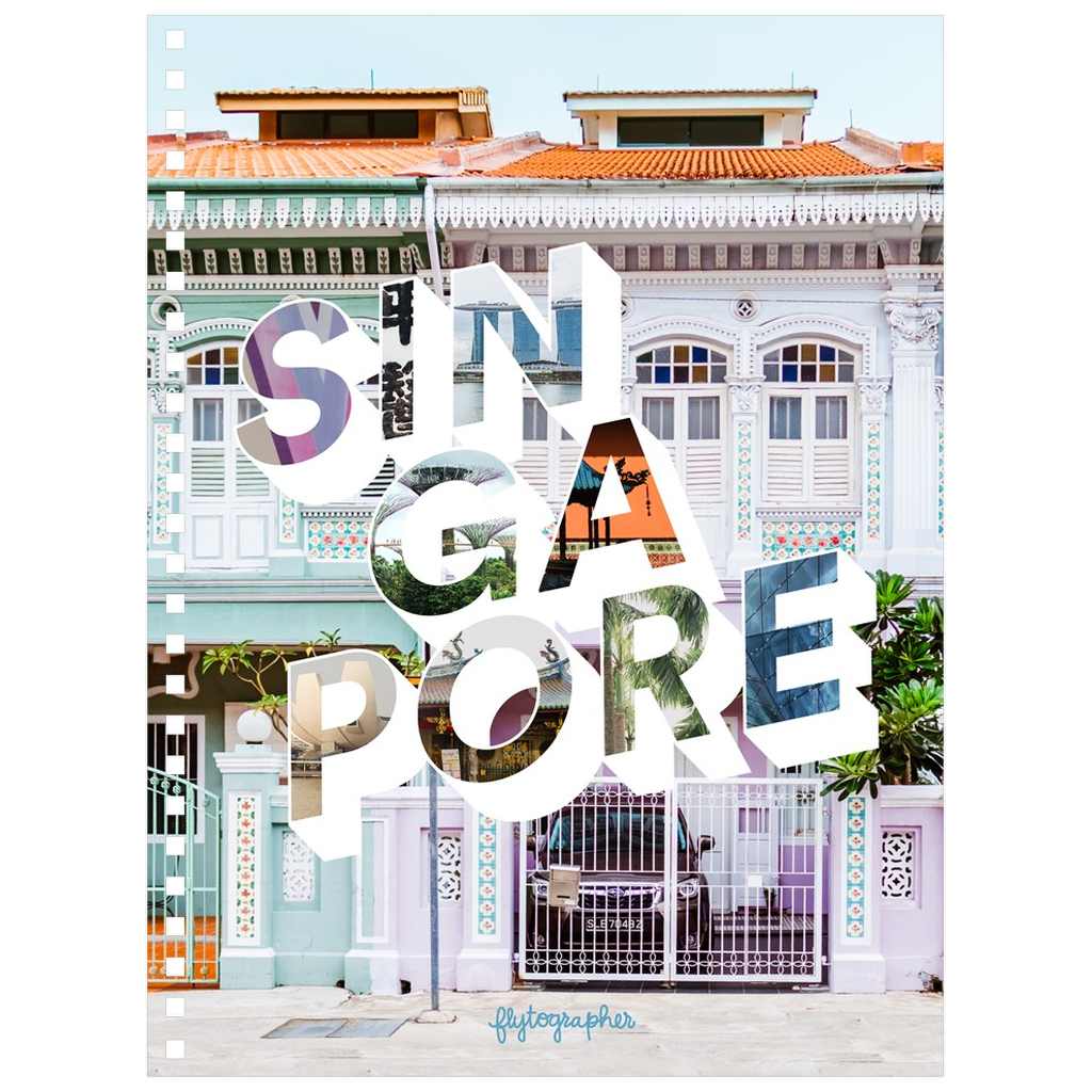 A medium-sized, 6.50x8.75 inch, spiral bound notebook with a picture of a place in Singapore on the cover
