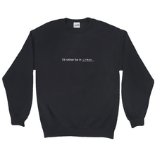 "Load image into Gallery viewer, Black polyester and cotton crewneck with the words ""I'd rather be in Lisbon"" in white font written on the front"