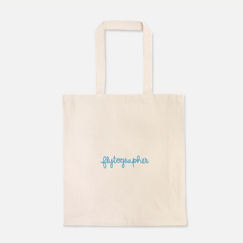 natural colour 100% Cotton Canvas bag with the word with Flytographer logo on the front