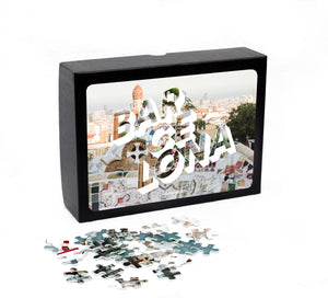 "Puzzle of a picture of Barcelona comes in a black box. Medium, 252-piece puzzle measures 14 inches by 10 inches and has a glossy finish. It comes in a black box with a 5 x 7 print of the image on top of the box. Box measures 5.625"" x 7.625"" x 1.2""."