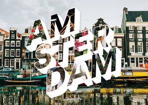 "Puzzle of a picture of Amsterdam that comes in a black box. Medium, 252-piece puzzle measures 14 inches by 10 inches and has a glossy finish. It comes in a black box with a 5 x 7 print of the image on top of the box. Box measures 5.625"" x 7.625"" x 1.2""."