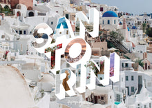 Load image into Gallery viewer, Medium, 252-piece puzzle measures 14 inches by 10 inches and has a glossy finish. It comes in a black box with a 5 x 7 print of the image on top of the box of Santorini.
