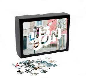 Medium, 252-piece puzzle measures 14 inches by 10 inches and has a glossy finish. It comes in a black box with a 5 x 7 print of the image on top of the box of Lisbon.