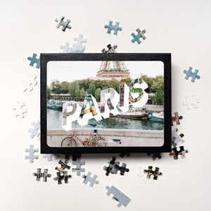 Medium, 252-piece puzzle measures 14 inches by 10 inches and has a glossy finish. It comes in a black box with a 5 x 7 print of the image of Paris on top of box.