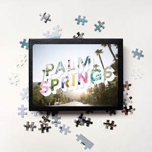Medium, 252-piece puzzle measures 14 inches by 10 inches and has a glossy finish. It comes in a black box with a 5 x 7 print of the image on top of the box of Palm Springs.