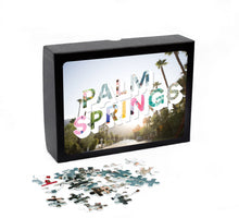 Load image into Gallery viewer, Medium, 252-piece puzzle measures 14 inches by 10 inches and has a glossy finish. It comes in a black box with a 5 x 7 print of the image on top of the box of Palm Springs.