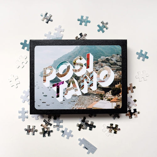 Medium, 252-piece puzzle measures 14 inches by 10 inches and has a glossy finish. It comes in a black box with a 5 x 7 print of the image on top of the box with image and word Positano