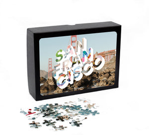 Medium, 252-piece puzzle measures 14 inches by 10 inches and has a glossy finish. It comes in a black box with a 5 x 7 print of the city image of San Francisco on top of the box