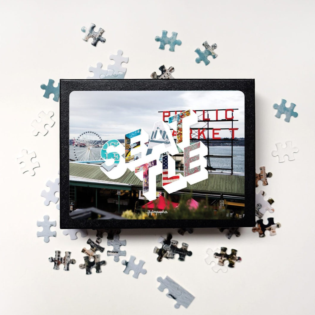 Medium, 252-piece puzzle measures 14 inches by 10 inches and has a glossy finish. It comes in a black box with a 5 x 7 print of the city image of Seattle on top of box.