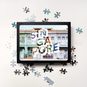 Medium, 252-piece puzzle measures 14 inches by 10 inches and has a glossy finish. It comes in a black box with a 5 x 7 print of the city image on top of the box of Singapore.