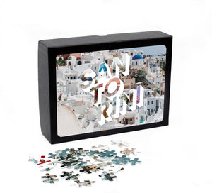 Medium, 252-piece puzzle measures 14 inches by 10 inches and has a glossy finish. It comes in a black box with a 5 x 7 print of the image on top of the box of Santorini