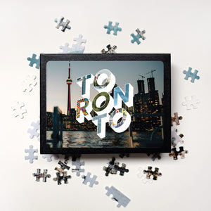 Medium, 252-piece puzzle measures 14 inches by 10 inches and has a glossy finish. It comes in a black box with a 5 x 7 print of Toronto city image on top of the box.