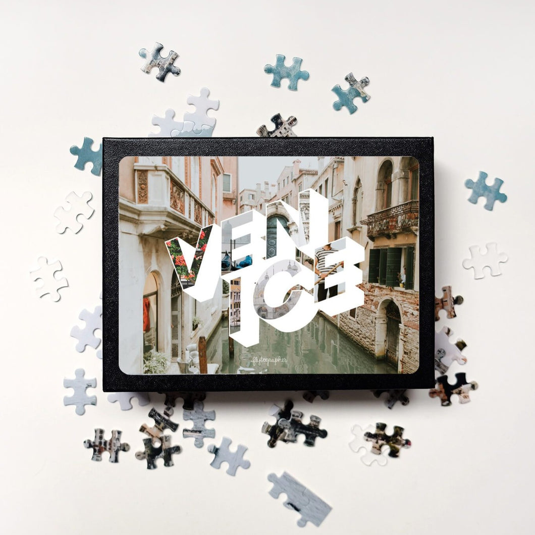 Medium, 252-piece puzzle measures 14 inches by 10 inches and has a glossy finish. It comes in a black box with a 5 x 7 print of Venice city image on top of the box.