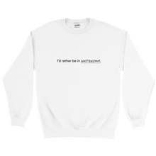 "Load image into Gallery viewer, White polyester and cotton crewneck with the words ""I'd rather be in Amsterdam"" in black font written on the front."
