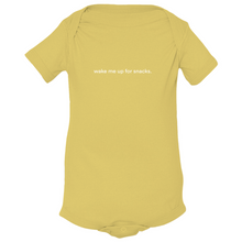 "Load image into Gallery viewer, Yellow 100% combed ringspun cotton fine jersey onesie with graphic saying ""wake me up for snacks"" on front"