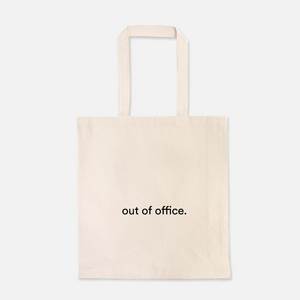 "natural colour 100% Cotton Canvas bag with the words "" out of office"" written on the front"