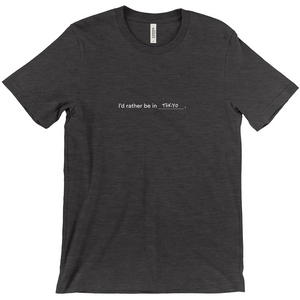 "Dark grey 100% cotton jersey soft T-shirt with the words ""I'd rather be in Tokyo"" in white font colour on front center"