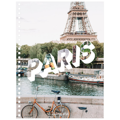 A 6.50x8.75 inch, spiral bound notebook with  a picture of Paris on the front cover.