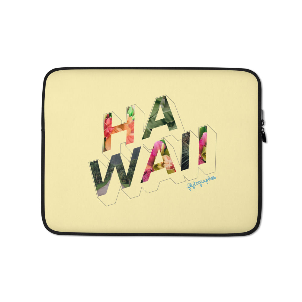 Yellow  laptop case with the word Hawaii written on the front in a colourful font
