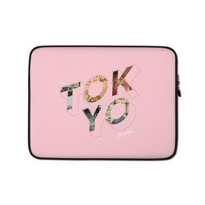 Pink laptop case with a colourful graphic and the word Tokyo on front