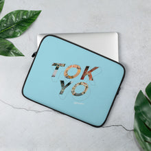 Load image into Gallery viewer, Blue laptop case with a colourful graphic and the word Tokyo on front