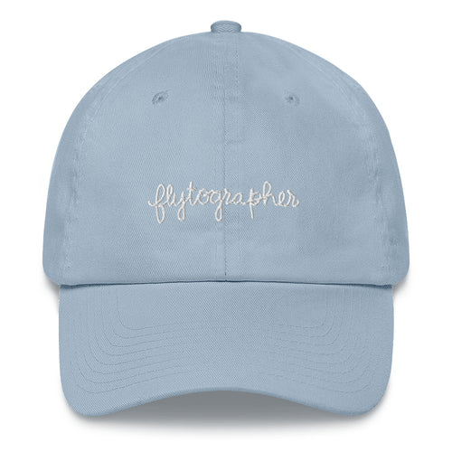 Light blue baseball cap has a low profile with an adjustable strap and curved visor.