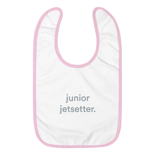Pink and white bib with graphic junior jetsetter written on front