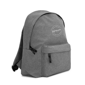 grey backpack with Flytographer logo on the front