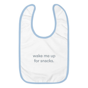 "blue and white bid with graphic saying ""wake me up for snacks"""