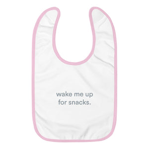 "Pink and white bid with graphic saying ""wake me up for snacks"""