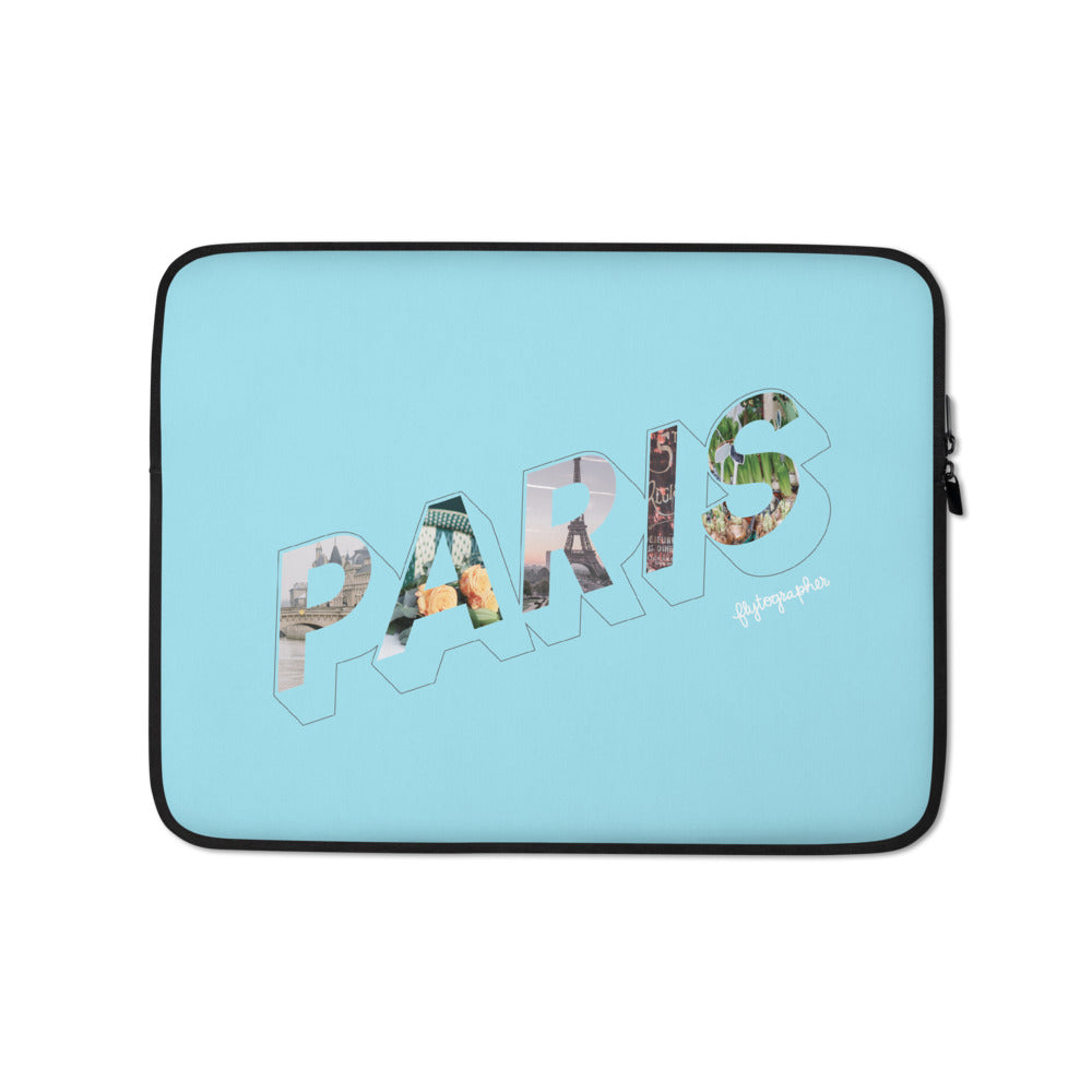 blue laptop case with a colourful graphic and the word Paris