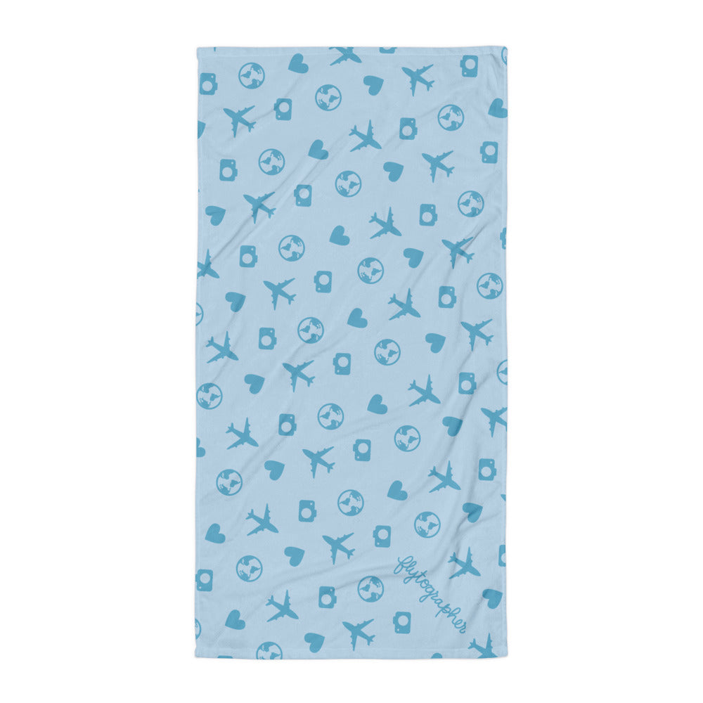 Blue graphic towel with planes, hearts, camera and earth  graphics