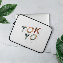Load image into Gallery viewer, White laptop case with a colourful graphic and the word Tokyo on front
