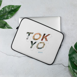 White laptop case with a colourful graphic and the word Tokyo on front