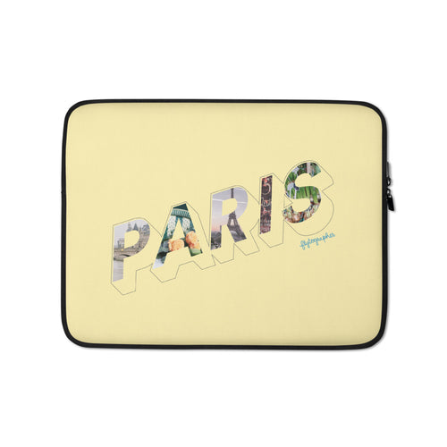 yellow laptop case with a colourful graphic and the word Paris