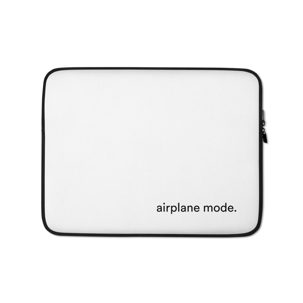 white laptop case with the words airplane mode written on the front