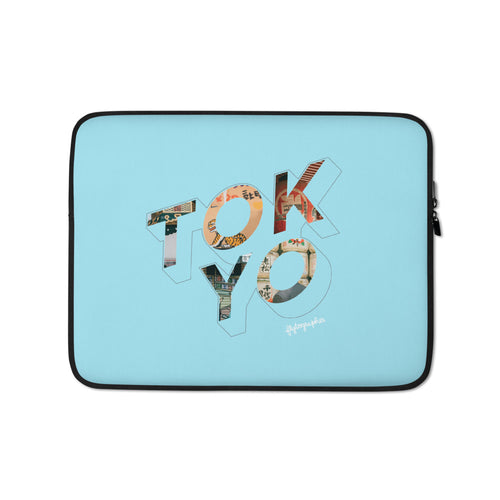 blue laptop case with a colourful graphic and the word Tokyo on front