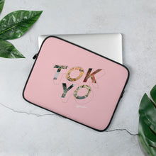 Load image into Gallery viewer, Pink laptop case with a colourful graphic and the word Tokyo on front