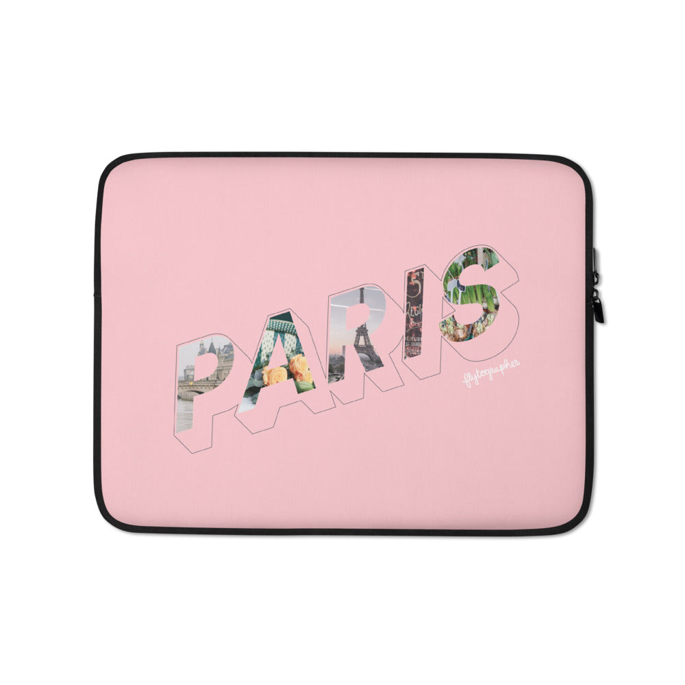 Pink laptop case with a colourful graphic and the word Paris