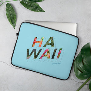 Blue  laptop case with the word Hawaii written on the front in a colourful font