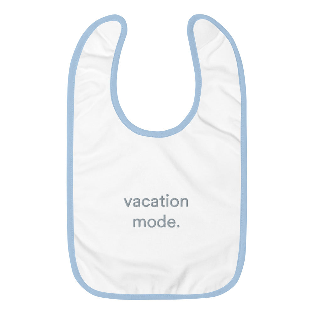 Blue and white bib with graphic vacation mode written on front