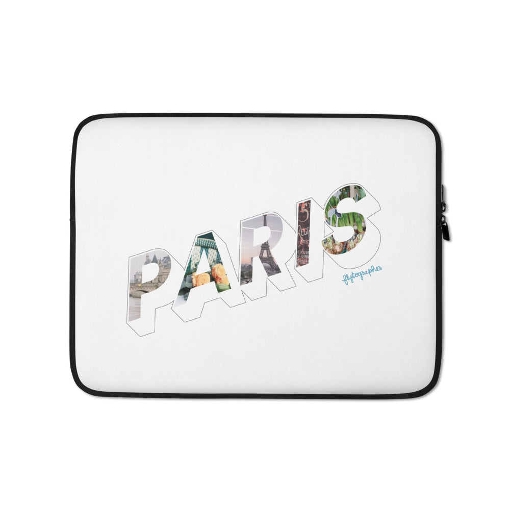 white laptop case with a colourful graphic and the word Paris